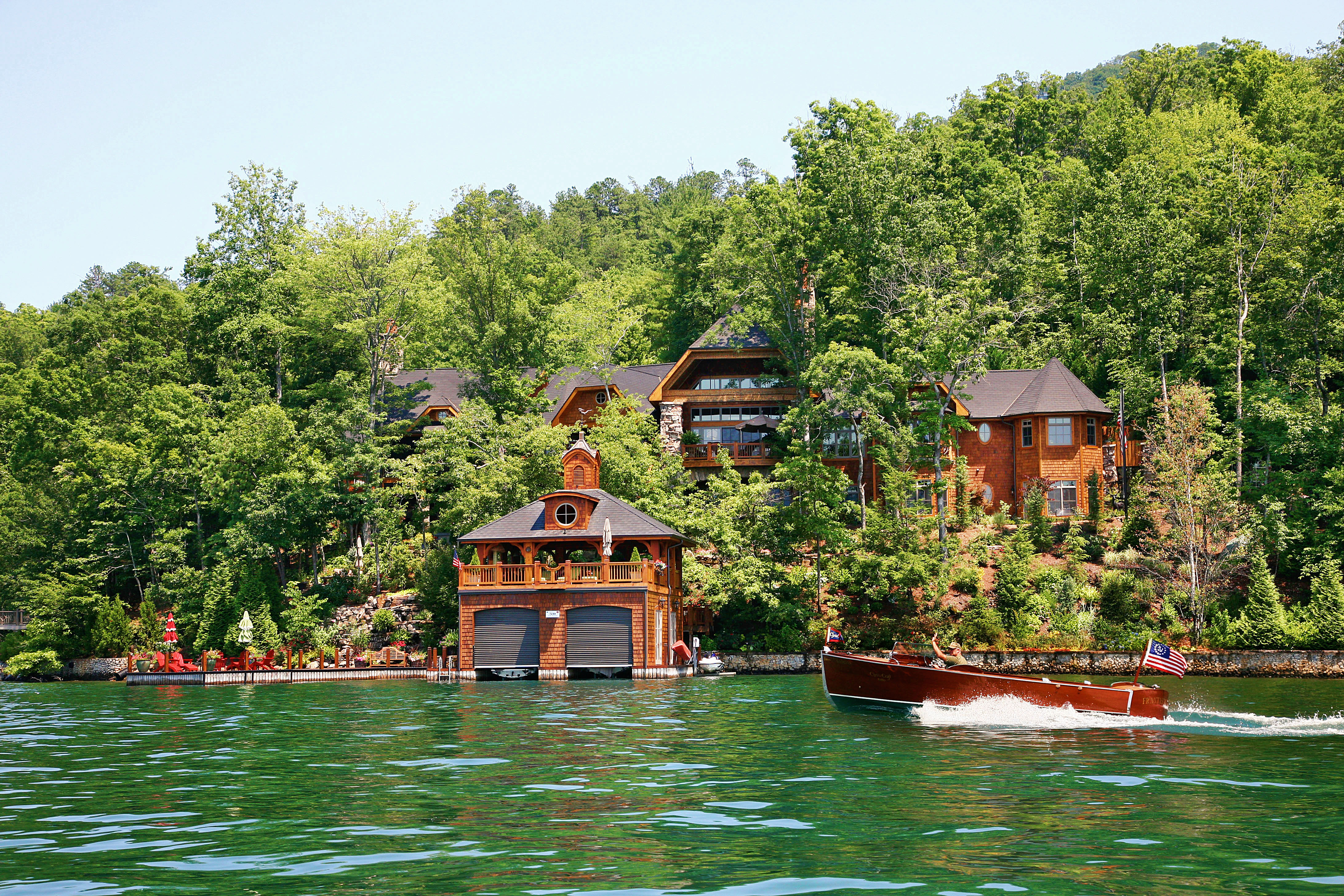 Stunning spaces charming rustic lakefront home the vht for Lakefront houses
