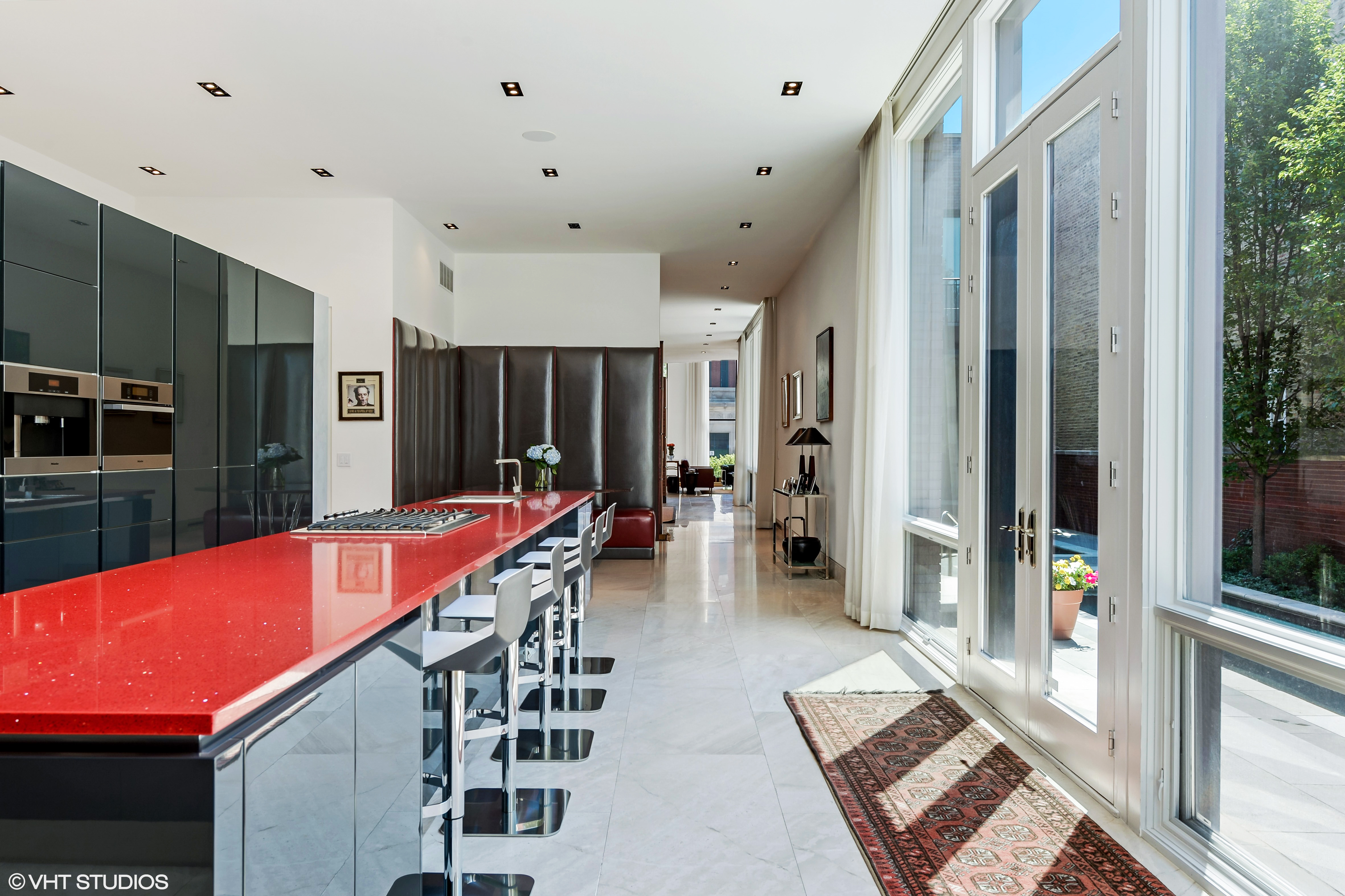 Open plan minimalist kitchen with red counter top